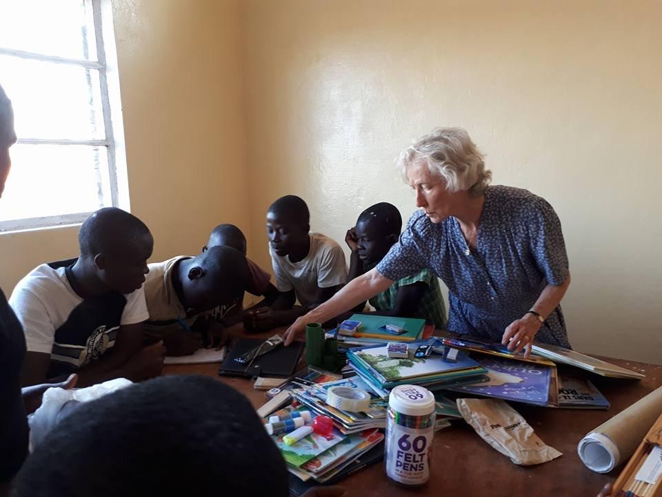 Marguerite explaining dominoes at Maison Kimbilio