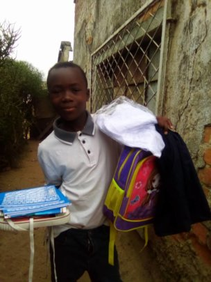 A child with his new school kit