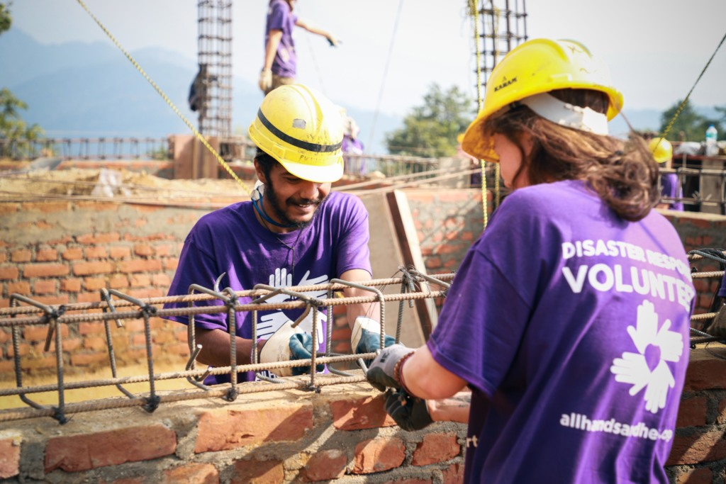 Volunteers working on a school foundation