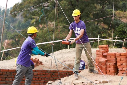 Volunteers working on a school foundation