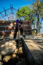 Volunteer working on rubbling Dhauleshwori