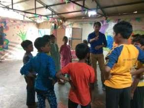 Ali facilitating games to encourage team work