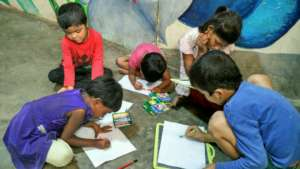 Children engaged in drawing