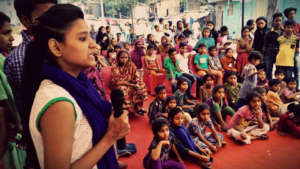 Kareena, speaking at a community event.