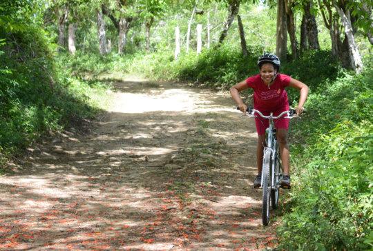 Viviana leading the way on her bike