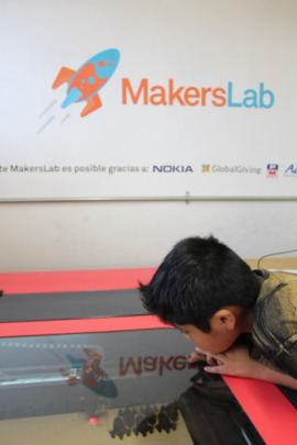 Emiliano looking the laser cutter working