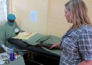 Diane comforting a patient in Ethiopia
