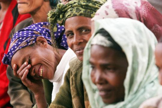 Women queue to receive antibiotics