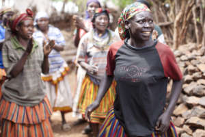 Women use song and dance to educate others