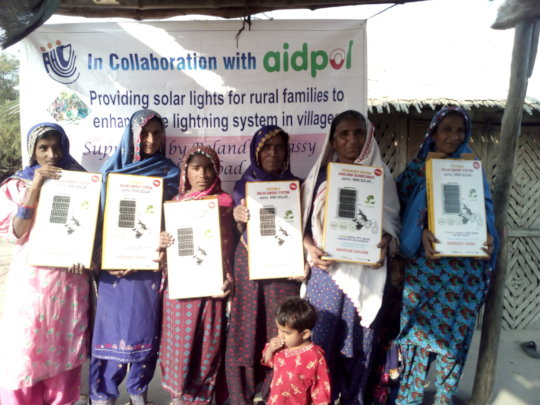 Women happy to recive solar lights for their house
