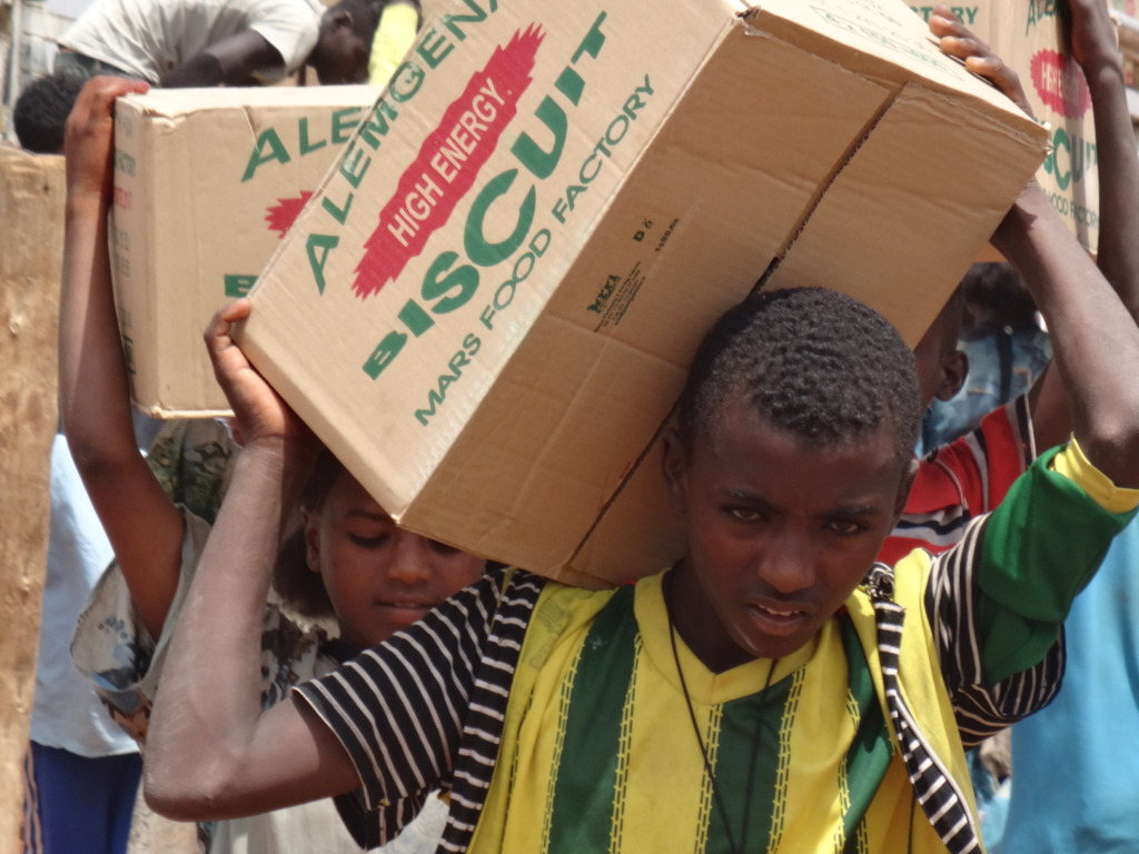 Students helping to carrying the biscuits
