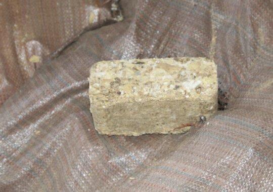 Brick made from peanut shells