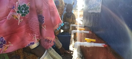 Women Filling their Pots with Water