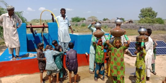 Children Happy after filling their Pots with Water