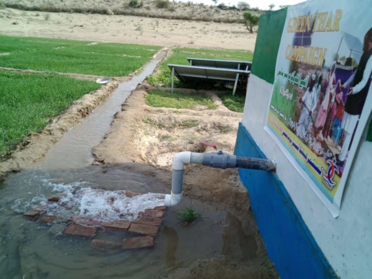 New water well with a Green Field.