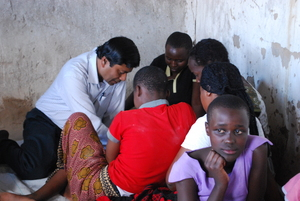 Lutfor, the Program Coordinator, playing chess with the girls