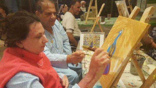 Olga painting during the Workshop