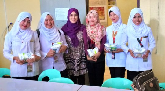 Nursing Students receiving med supplies from AAI