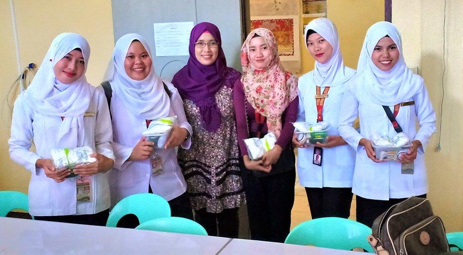 Nursing Students receiving med supplies from AAI