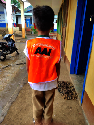 New mini-nurse wearing uniform vest from AAI