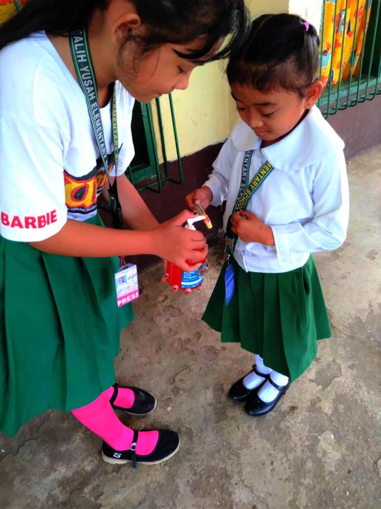 Little Nurse teaches 1st grader to brush teeth
