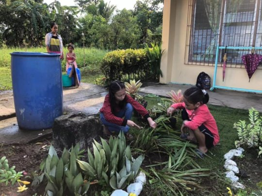 Children assist school nurses cleaning mosquitos