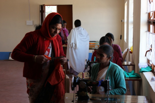 Lessons on tailoring for village women by ET staff