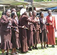 Local WMI officials at a graduation ceremony