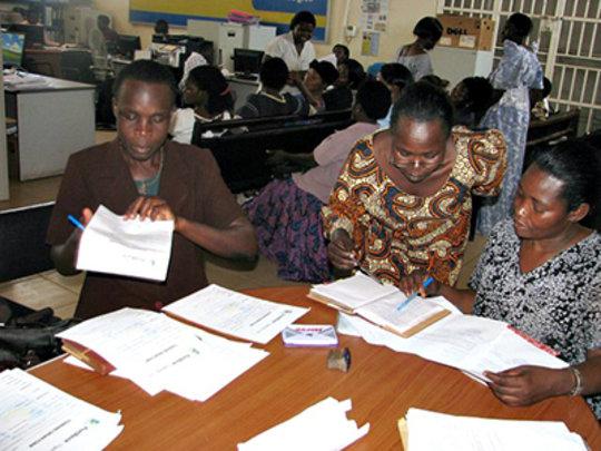 A graduating group receives formal bank loans