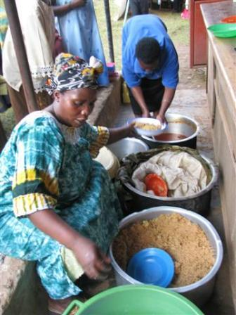 Kamida Wosukira, WMI borrower, caters lunch for a group meeting