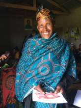 A new borrower holds her 200,000 shilling loan