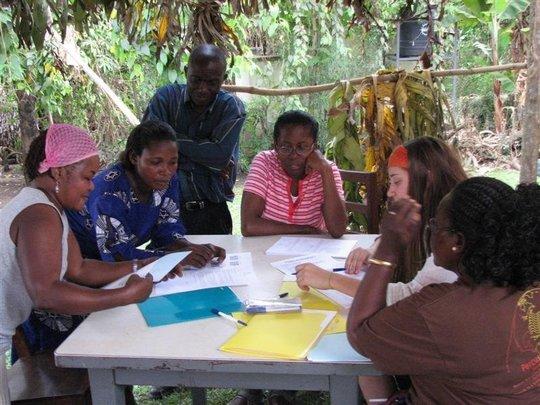WMI staff meeting with borrowers