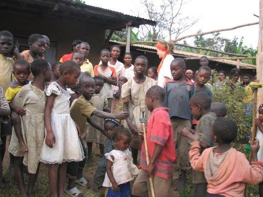 Children showing WMI staff the village