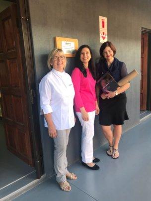 Dr Sarah Zeb (middle) with Hlokomela staff.
