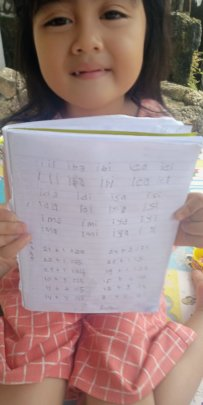 The student shows her hands writing work