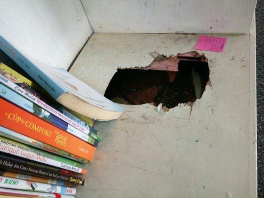 The broken bookshelf