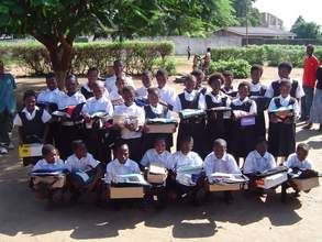 Scholarship recipients in the yard outside their school