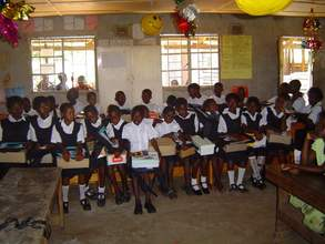 Scholarship recipients with their school supplies in the classro