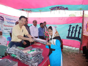 Student Receiving School Uniform and Supplies