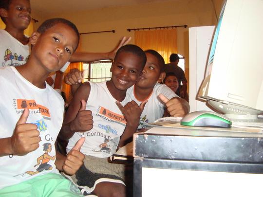 young kids in school uniforms happy at computer school