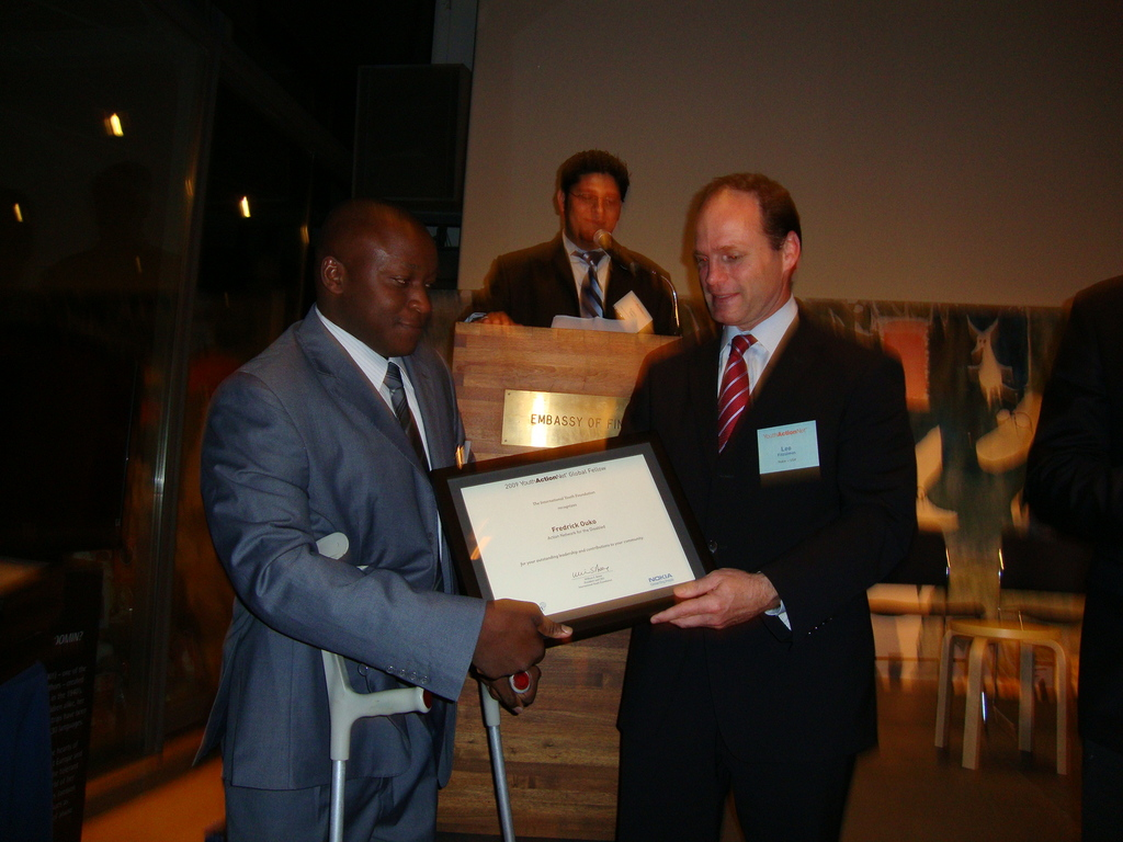 Fredrick receiving YouthActionNet Award