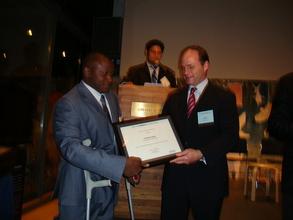 Fredrick receiving YouthActionNet Award