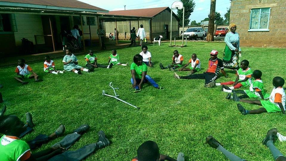 Children with disabilities being taught sports