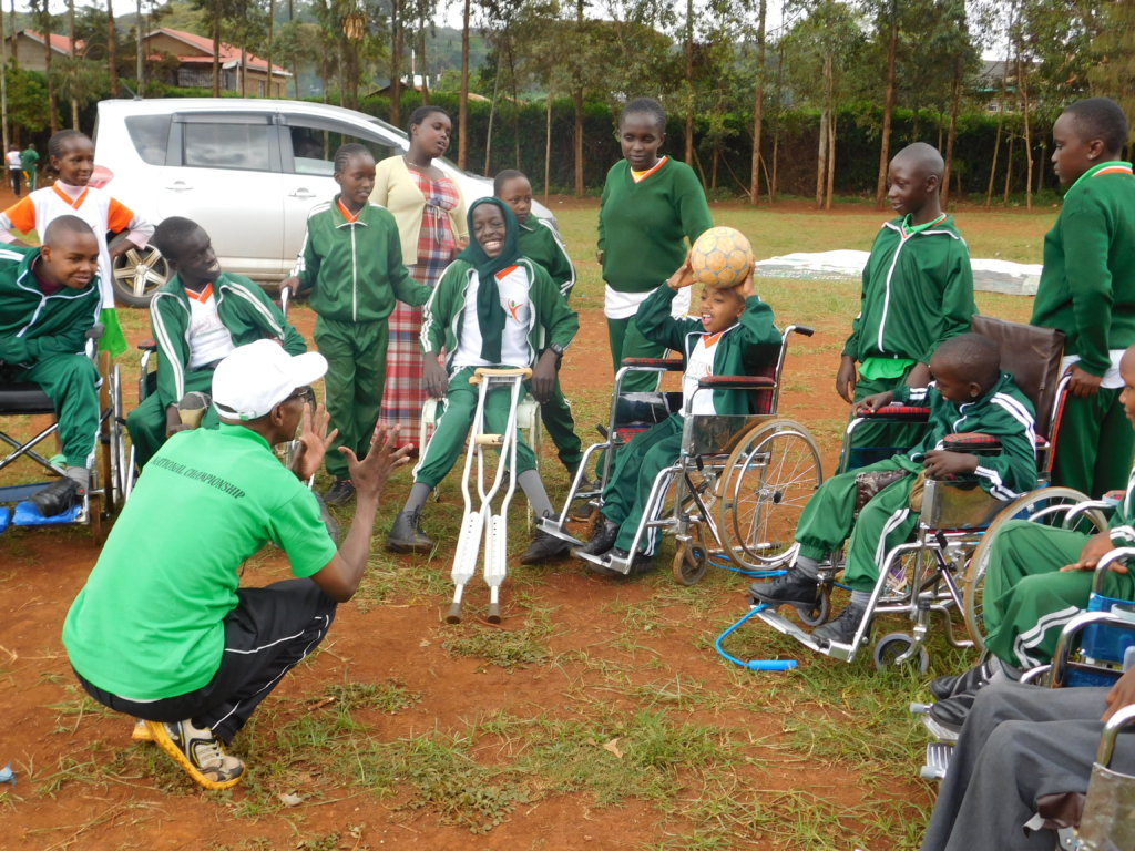 Children enjoying a game on wheelchair
