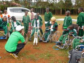 Children enjoying a game on wheelchair