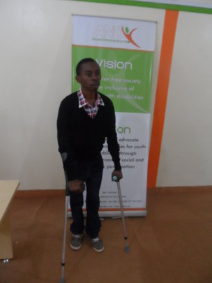 A recipient of an elbow crutch donation