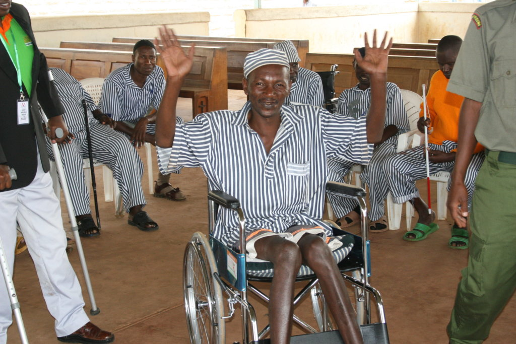 Smiling after receiving a wheelchair donation