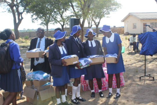 beneficiaries receive uniforms and sanitary wear