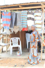 A project beneficiary in her clothes shop