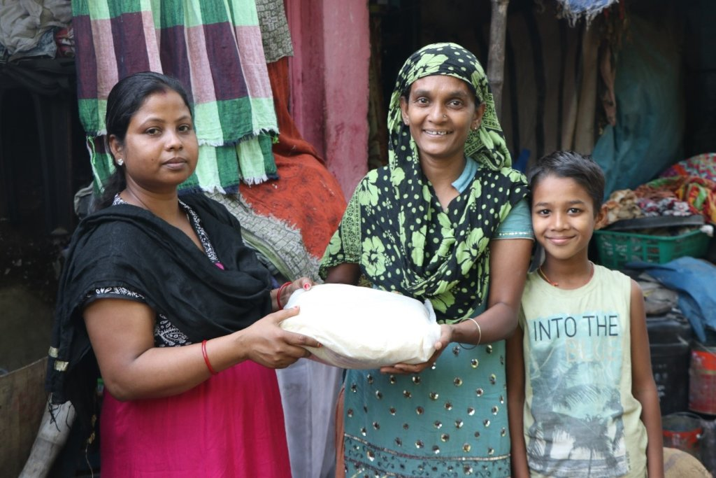 Shaheen (right) receives her food rations
